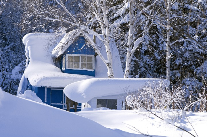 Winter landscape with a snow-covered country house